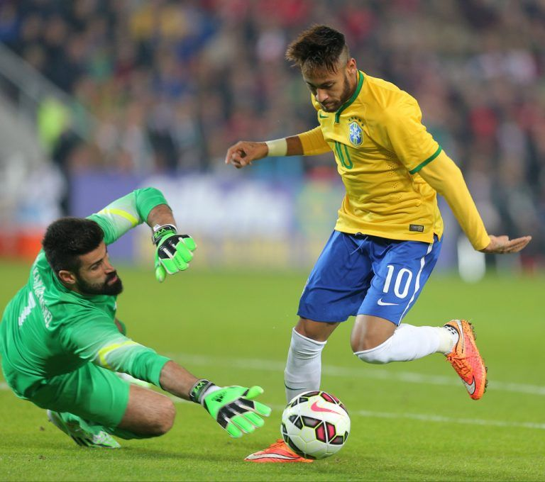 Brazil's Neymar JR, right, is about to pass Turkey's goalkeeper Volkan Demirel to score a goal during their friendly soccer match with Turkey at Sukru Saracoglu Stadium in Istanbul, Turkey, Wednesday, Nov. 12, 2014. (AP Photo)
