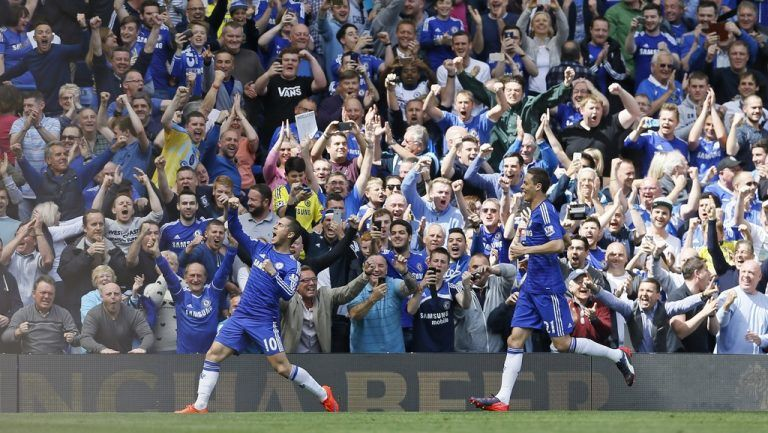 Chelsea's Eden Hazard, left,, celebrates with Nemanja Matic after scoring the opening goal during the English Premier League soccer match between Chelsea and Crystal Palace at Stamford Bridge stadium in London, Sunday, May 3, 2015.   (AP Photo/Kirsty Wigglesworth)