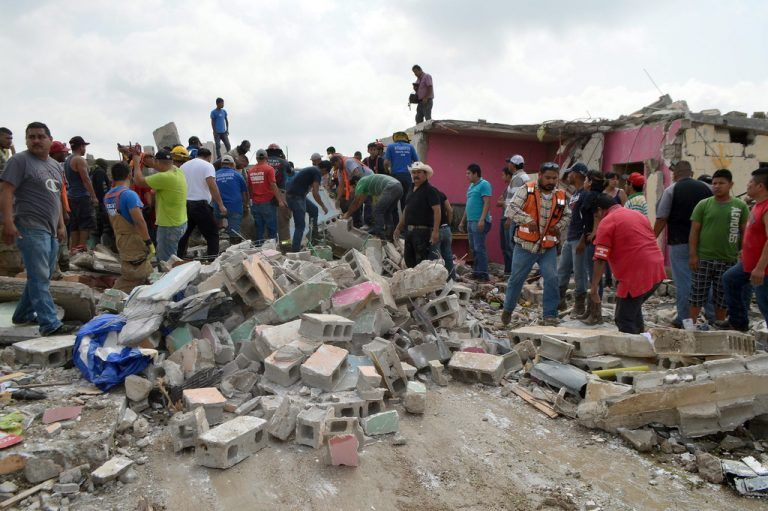 epa04767796 Emergency workers and inhabitants inspect an area after the passage of a tornado in Ciudad Acuña, North of Mexico, 25 May 2015. About 1,500 houses were destroyed by the twister, which lasted just six seconds and lifted occupied vehicles off the ground, the mayor told Mexican media. Coahuila secretary of Government Victor Zamora confirmed that 13 people were died and at least 230 were injured. EPA/STR