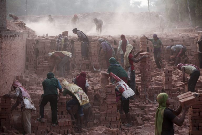 epaselect epa04756182 Nepalese laborers work at a brick factory in Bhaktapur, Nepal, 19 May 2015. Nepal is facing an acute brick crisis after some 40 million houses were damaged and 80 percent of brick kilns were also damaged due to two major earthquakes on 05 April 2015 and 12 May 2015. The official death toll for the 12 May 7.3 magnitude quake rose to 117, authorities said, in addition to the 8,202 victims claimed by the April 25 earthquake. EPA/NARENDRA SHRESTHA