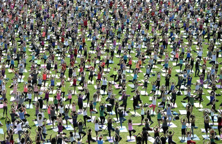 People take part in a yoga session on Parliament Hill in Ottawa on Wednesday, May 6, 2015. Every week in May free Yoga classes are offered featuring different yoga instructors in Ottawa. (Justin Tang/The Canadian Press via AP) MANDATORY CREDIT