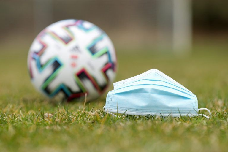 EGGERSDORF,AUSTRIA,04.APR.20 - SOCCER - tipico Bundesliga, photoshooting due to the SARS-CoV-2 crisis, corona crisis. Image shows a face mask and the official league ball. Photo: GEPA pictures/ Christian Walgram