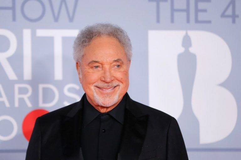 British singer Tom Jones poses on the red carpet on arrival for the BRIT Awards 2020 in London on February 18, 2020. (Photo by Tolga AKMEN / AFP) / RESTRICTED TO EDITORIAL USE Ð NO POSTERS Ð NO MERCHANDISEÐ NO USE IN PUBLICATIONS DEVOTED TO ARTISTS