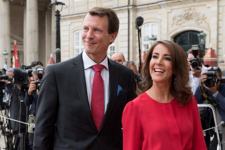 (FILES) This file photo taken on August 28, 2018 shows Princess Marie of Denmark and Prince Joachim of Denmark arriving at the Amalienborg Castle in central Copenhagen. - Danish Prince Joachim, 51, has been successfully operated on a blood clot in his brain at the University Hospital Centre CHU Toulouse. His state is